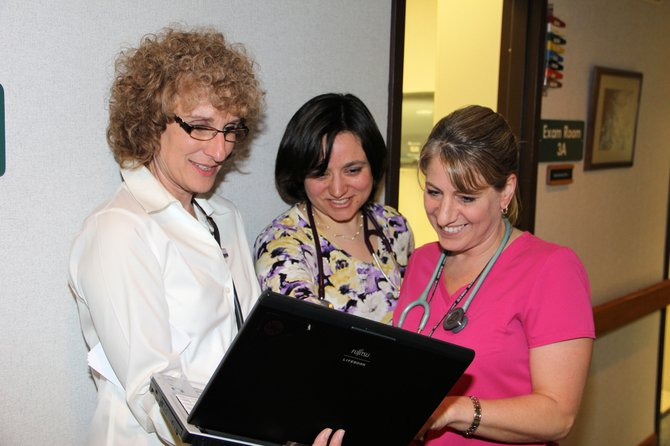 Donna Gorton, left, director of nursing for Hudson Headwater Health Network, looks over reports with Dr. Kathleen Pangia and medical assistant Angel Perkins at the Ticonderoga clinic..