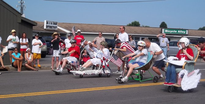 Participants in the annual Stickley Chair Race prepare to take off from the starting line.