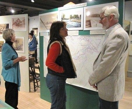 During a reception at the Warrensburgh Museum of Local History, Delbert Chambers (right) talks to a visitor to the popular venue. Due in part to an 80 percent increase in adult visitors this past year, the museum is now seeking volunteer greeters.  The museum has garnered regional attention for its professional, informative presentation of artifacts and documents.