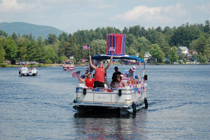 Residents celebrate Independence Day during the July 4 Boat Parade on Lake Flower in Saranac Lake.