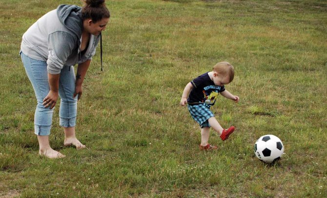 Kaly Pryor and Jakob Rossing play soccer during the Tupper Lake Independence Day celebration July 3.