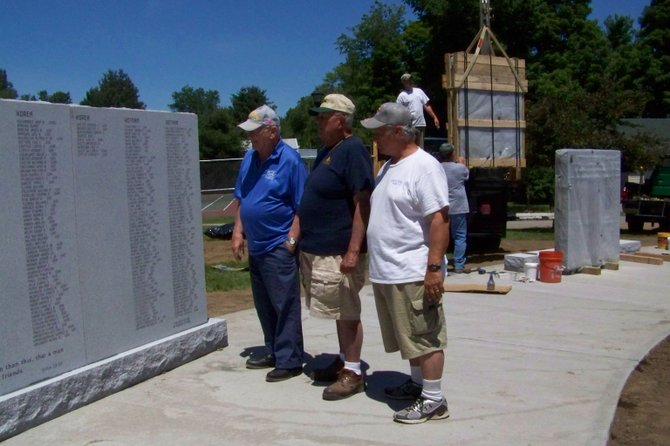 Town of Chester veterans watch granite slabs being dropped into place in mid-June for the Chester Veterans Memorial, which is to be dedicated in a ceremony at 5 p.m. Saturday July 7.