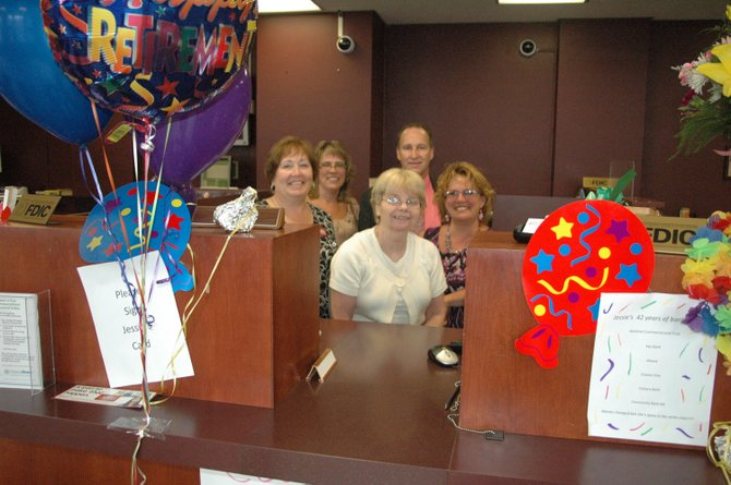 Jessie Strong, center, celebrates her retirement after 42 years in the banking business along with co-workers Darlene LaMountain, branch manager Valerie Daniels, Kent Backus and Helen Kennedy.