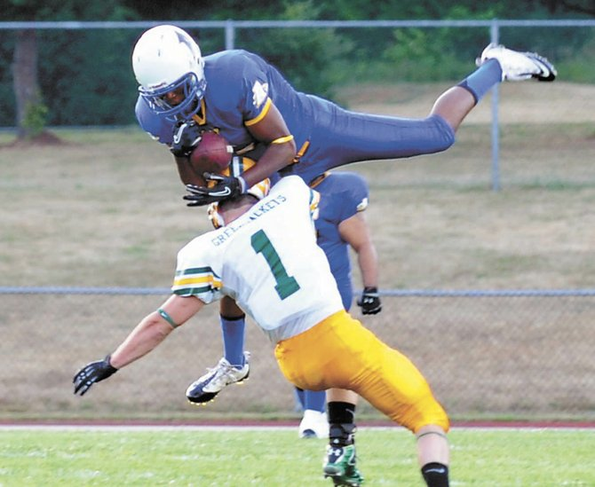 Albany&#39;s Issmal Green makes a leaping catch during Saturday&#39;s home opener against Glens Falls at Christian Brothers Academy.