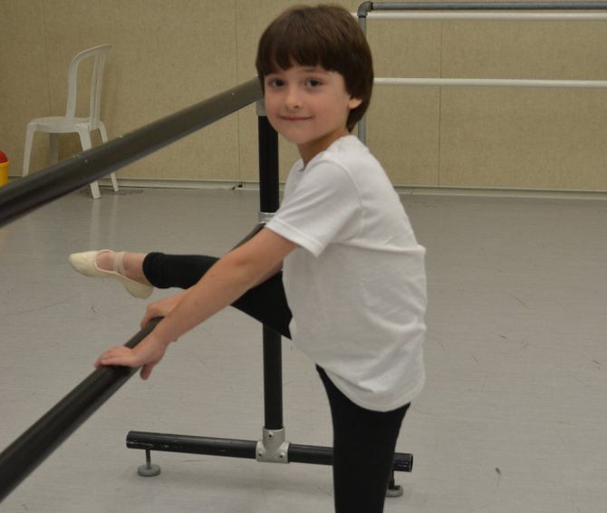 "John Zorbas of Colonie takes to the bar during a ballet class. He has been dancing for a year and will be stepping on SPAC's stage with the NYC Ballet in their performance of ""Firebird"" on Thursday, July 12, and Friday, July 13."