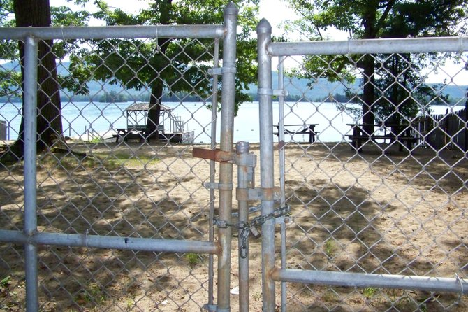 Whether or not to lock up Diamond Point Beach when no lifeguards on duty — an action taken recently by the lake George Town Board to ward off potential lawsuits — has angered local residents, who say they are being discriminated against and that the  town board is misinterpreting state law.