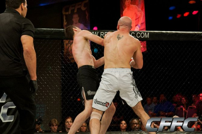 In his first professional Mixed Martial Arts fight, Warrensburg's own Lenny Baker delivers a punch shortly before knocking out Judah Ciervo of Philadelphia in the first round. The matchup was held June 30 in the Resorts Casino in Atlantic City, N.J.
