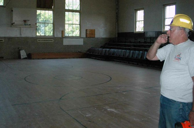 Jim King walks through the gym of the former Keeseville Civic Center, which he and a group of residents are looking to renovate and bring back to the community.