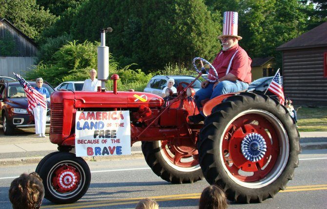 George Virgil atop his entry for Best Dressed Tractor in the Indian Lake parade