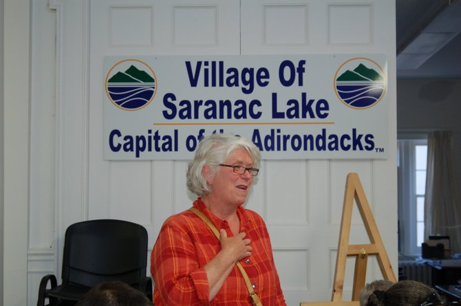 Gail Brill reports to the Saranac Lake Village Board Monday, July 9 about her experiences as an Adirondack Ambassador, welcoming train tourists at the Union Depot arriving from Lake Placid.