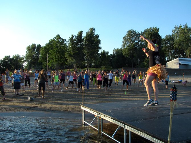The Tiki Torch Zumbathon, an event that raised money to build a handicap-accessible treehouse along the Saranac River Trail, drew more than 100 people to the City Beach June 29.