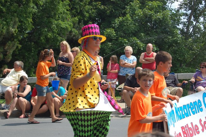 A clown cools people off during the July 4 parade in Plattsburgh.