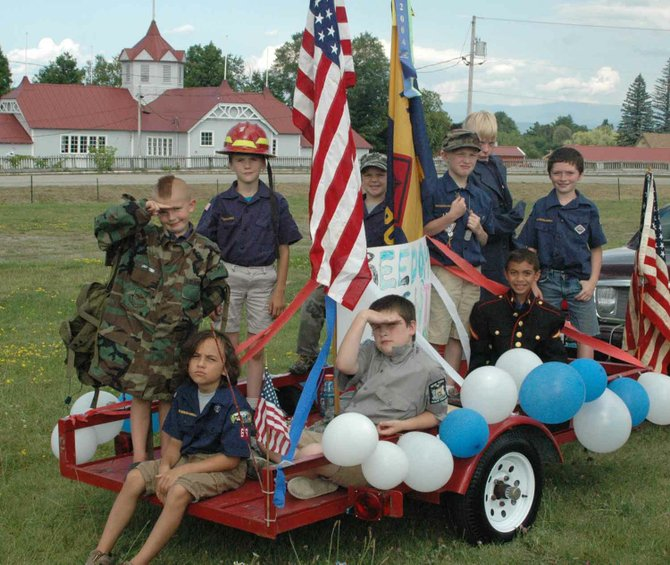 Members of the Westport and Elizabethtown Cub Scout Pack 63 honored those who serve during a Fourth of July parade..