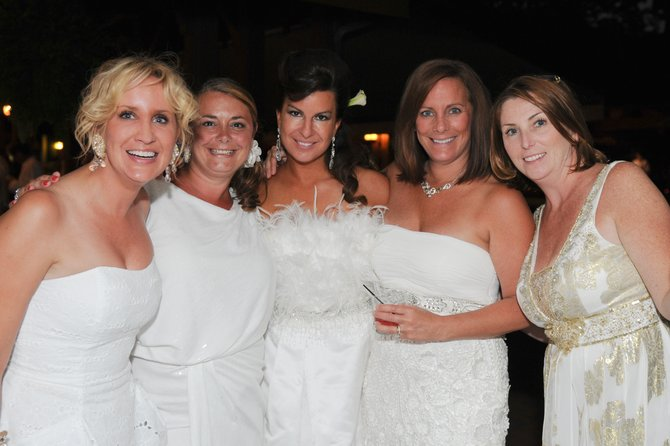 Some scenes from last year's White Party to benefit Saratoga Bridges. Attire is generally white, though some attendees throw in splashes of color. The gala is the organization's biggest fundraiser of the year and helps support programs and services for the developmentally disabled. Photo courtesy of Image Photos and Events.