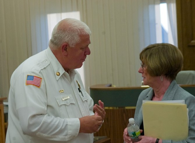 Plotterkill Fire Department Chief and County Fire Advisory Board Chairman John Tobiassen talks to Schenectady County Legislature Chairwoman Judith Dagostino on Tuesday, July 10, after the county approved a central dispatch plan.
