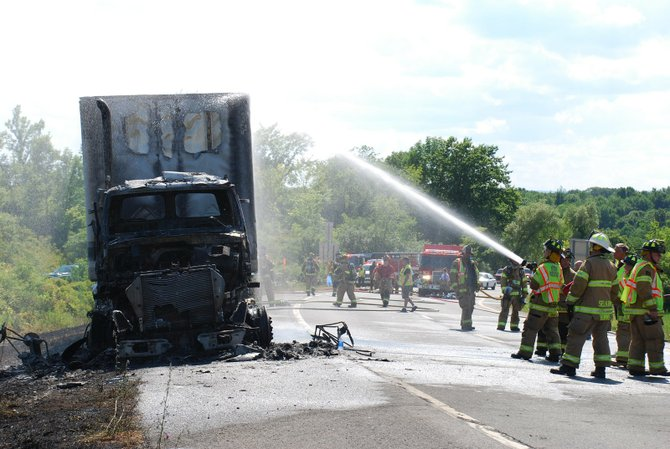 Traffic was stopped on the afternoon of Wednesday, July 11 after a tractor trailer caught on fire near the Delmar Bypass, according to Elsmere Fire officials.
