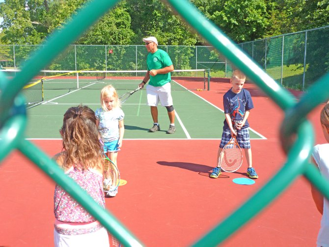 Bethlehem youth tennis Instructor Dan Creamo teaches a beginner class filled with students in grades from kindergarten to second grade. 