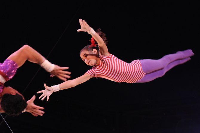 In a recent performance of the Big Apple Circus, the youngest of the Flying Cortes aerialists, 10-year-old Ysabella Wallenda-Cortes, flies through the air to be caught in her father&#39;s arms.
