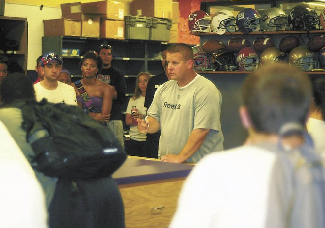 New York Giants training camp director of operations Kevin Galuski meets with his interns last Thursday at the University at Albany.
