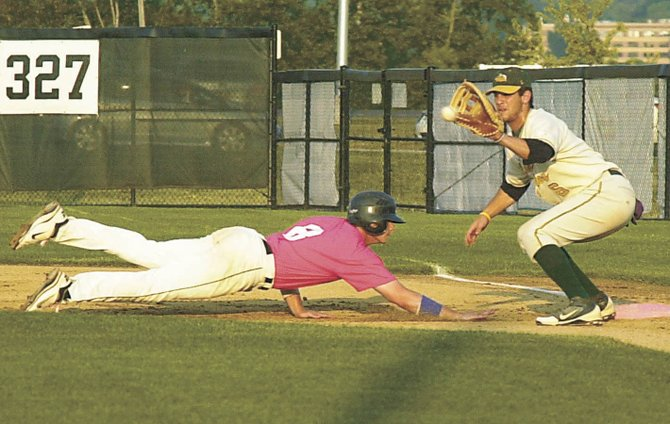 Albany&#39;s Jack Wietlispach tries to beat the pick-off throw to first base during Saturday&#39;s Perfect Game Collegiate Baseball League game against Glens Falls at Bob Bellizzi Field.