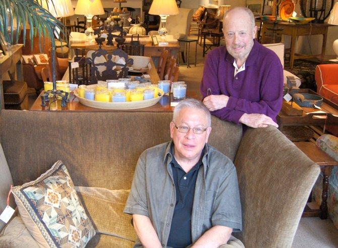 John David Hunter, left, sits beside his partner Bob Winston in their new store, J.D. Hunter Home, located at 55 Albany St. in Cazenovia.