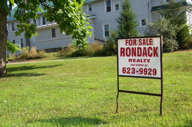 Temporary signs stuck into lawns by contractors or real estate agents may be a little less commonplace in the town of Lake George, if regulations now under consideration by the town board are adopted.