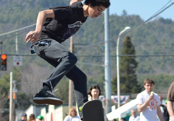 A local skateboarder flies off a ramp during a demonstration held in conjunction with the 'Sham Rock the Block' event held on St. Patrick's Day weekend in Lake George. More than a dozen teenagers have been working for years to establish a skate park where they can hone their skills. As of this week, the park is closer to reality, thanks to new funding sources.