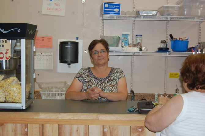 Carla Brotherton behind the counter of her ice cream parlor 20 Below.