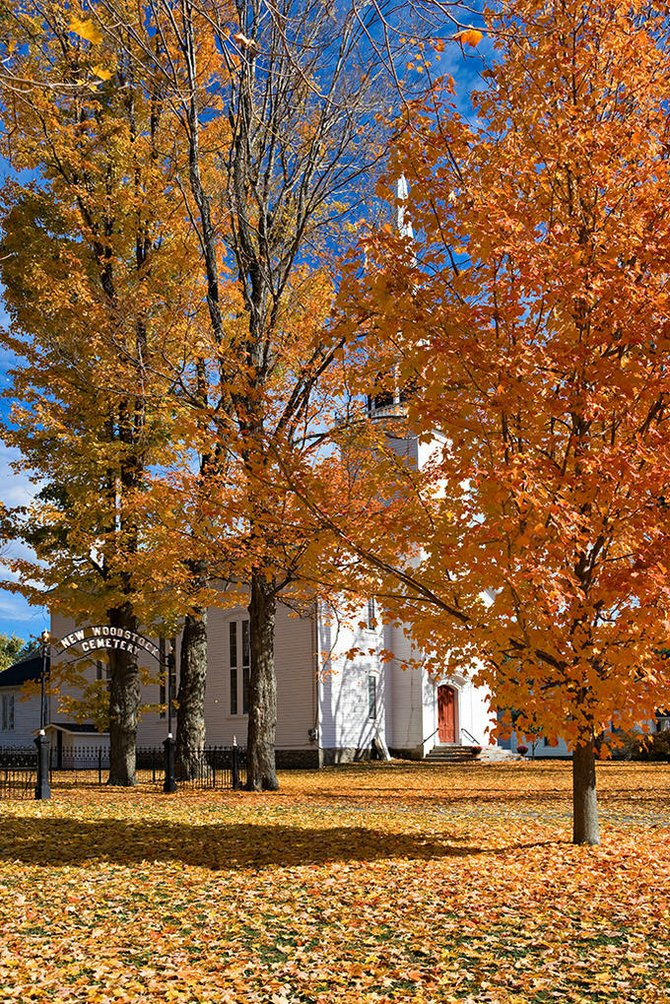 """Village Church in Fall Colors"" by photographer Jerry Weimar. An exhibit of Weimar's work will be at the New Woodstock Free Library through Aug. 31."
