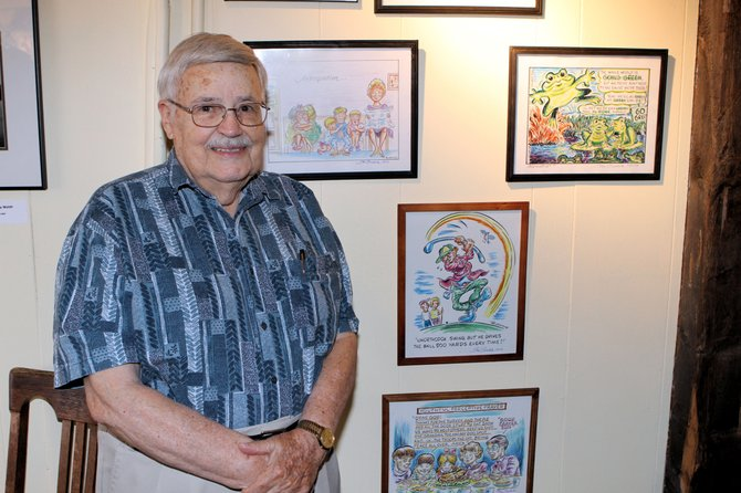 Stan Burdick, a cartoonost, exhibits his work at the new Downtown Gallery in Ticonderoga.