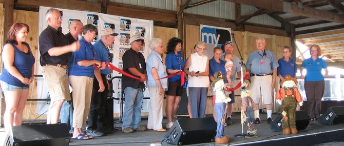 Fair dignitaries kicked things off on Monday night, July 16, by cutting a ribbon signed by each of them and declaring the 2012 Saratoga County Fair ready for business. The fair officially opened its gates on Tuesday, July 17.