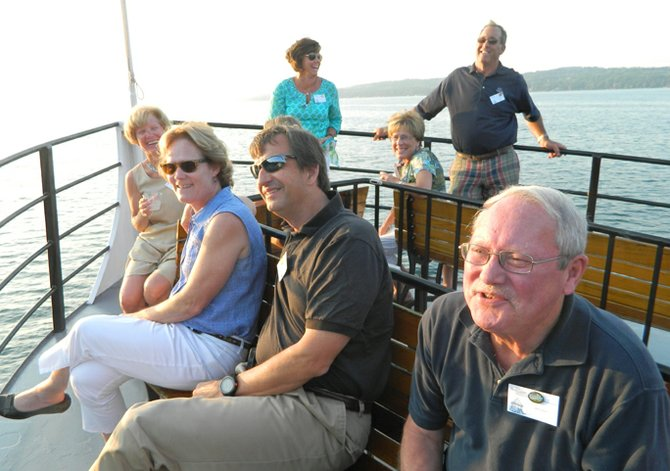 Members of the Skaneateles village delegation who attended the Onondaga County mayors Association dinner aboard the Judge Ben Wiles last week relax on the top deck after dinner. Seated from right, Municipal Board member Walt Blackler, Village Clerk Patty Couch (back row), Director of Municipal Operations Bob Lotkowictz and his wife Sue Edinger, and Village trustee Sue Jones. Standing from left, Planning Board member Megan Keady and Village Trustee Marc Angelillo.