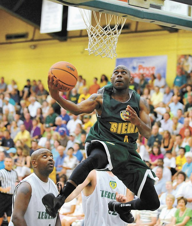 Tay Fisher cuts to the basket during last Thursday's Siena Legends basketball game at the Alumni Recreation Center.