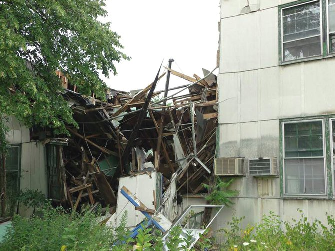 A building at the former Scotia Navy Depot partially collapsed on Sunday, June 15, 2012. Town officials called upon federal officials to demolish the collapsed building.
