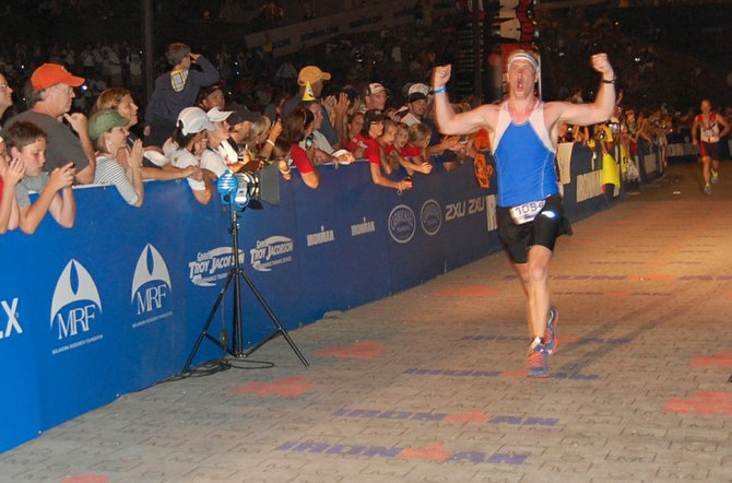 Christopher McCarthy of Syracuse approaches the finish line after competing for more than 14 hours in the 2012 Lake Placid Ironman competition. 