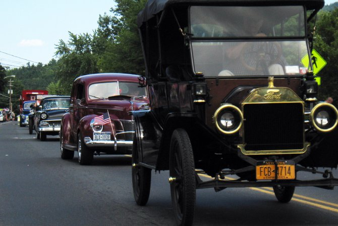A row of classic cars cruised down Rt. 9 Saturday during the Etown Day parade.