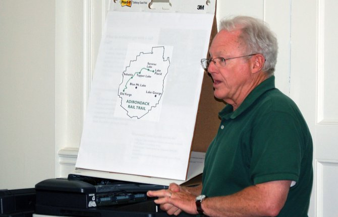 Adirondack Recreational Trail Advocates Board member Lee Keet gives a presentation on the 90-mile Great Adirondack Recreation Trail July 23 to the Saranac Lake Village Board.