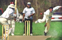 Tr-City Cricket Club playing at Kailberg Field in Schenectady... Batsman Mike Persaud awaits the delivery, while umpire Zoeb Zavery looks on....