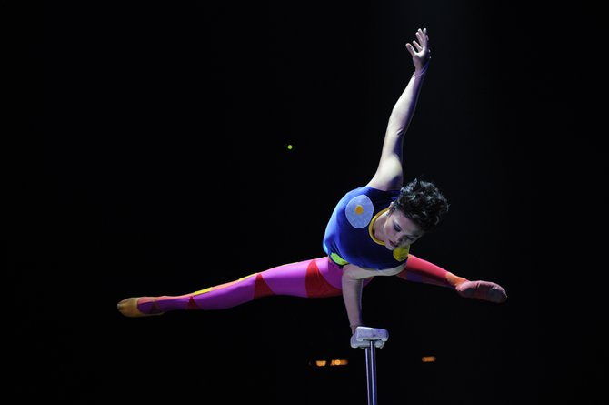 Mesmerizing her audience, Big Apple Circus performer Melanie Chy of Switzerland performs a balancing feat in a performance of the Big Apple Circus, which is [resenting two shows daily through Sunday July 29. . Tickets are available at the box office at Charles Wood Park, or at: www.bigapplecircus.org, or by calling (888) 541-3750.