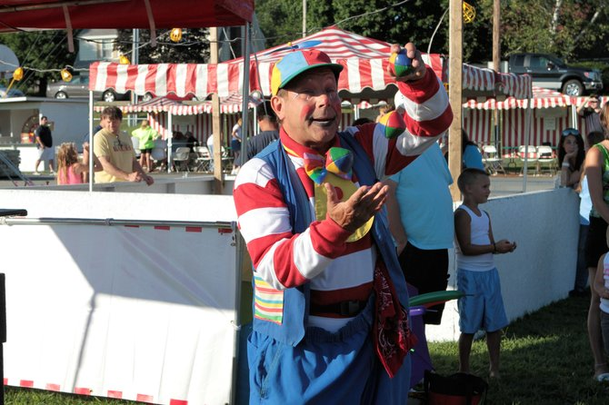 Roscoe the clown entertains children at the 2011 Smoke Eaters' Jamboree. The 2012 edition of this carnival-style event — the 50th annual Jamboree — is to be held the evenings of Friday July 27 and Saturday July 28 in Warrensburg