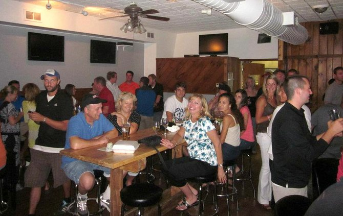 Area residents sample the local craft beers, wine and cider while sampling Henneberg Tavern's many menu items during the restaurant's grand opening on July 27. The kitchen will be open from 3 to 10 p.m. daily, and feature a fish fry on Fridays.