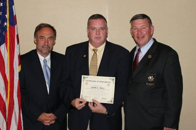 Madison County Undersheriff John E. Ball, center, receives a certificate upon completion of the 26th Annual Undersheriffs' Training Program, with New York State Sheriffs' Association Institute Executive Director Chris O'Brien, left, and New York State Sheriffs' Association President and Putnam County Sheriff Donald B. Smith.