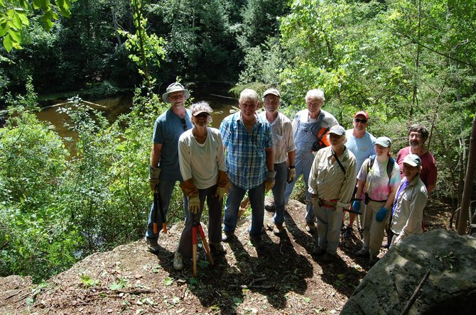 Champlain Area Trails Executive Director Chris Maron (fourth from left) helped organize the volunteer trail crew day that recently created a trail to hidden quarry.