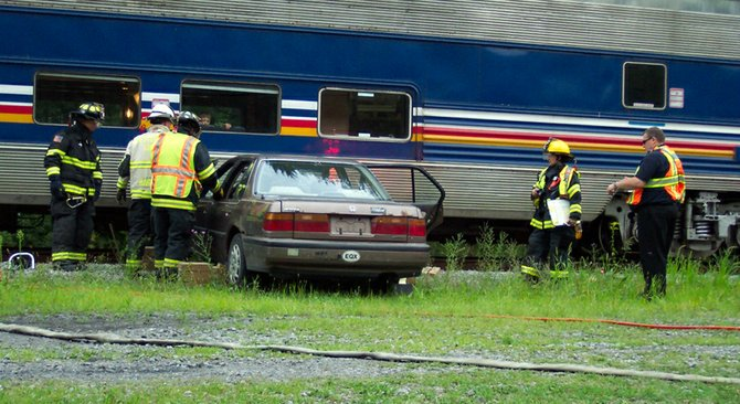 Emergency responders take part in a mock disaster on Wednesday, July 25 in Riparius. The drill simulated a car-train accident along the Saratoga & North Creek Railway.