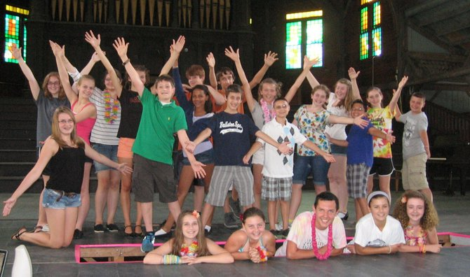 "The cast of ""Honk!"" practice their group pose on Monday, July30, during rehearsal. The Summer Stars and Carpe Diem Productions group will perform at the Round Lake Auditorium on Friday and Saturday, Aug. 3 and 4."