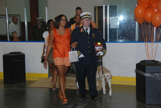 Laurel McAdoo is escorted by Bethlehem fire officials into the ceremony to celebrate her son&#39;s life. 
