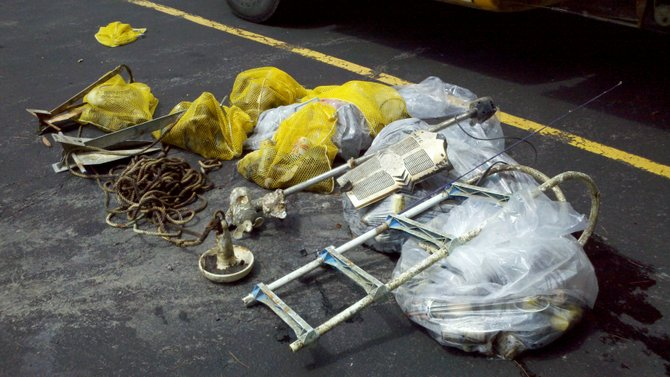 Shown is one small portion of the trash retrieved from Lake George — at one location — by volunteers during last year's 'Keep the Queen Green Day.' Local citizens removed trash, household items, fast-food litter, anchors, a boat ladder — even two car batteries — from Lake George during the day's cleanup effort  This year's event is set for Saturday April 4, and all are invited to pitch in to keep the lake scenic as well as minimize pollution that compromises the quality of water that so many area residents drink.