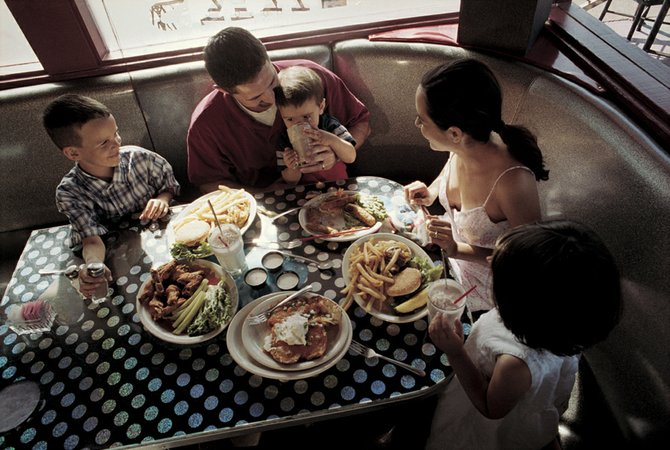 Dining out as a family doesn't have to be a cringe-worthy experience if you remember to keep your expectations reasonable.