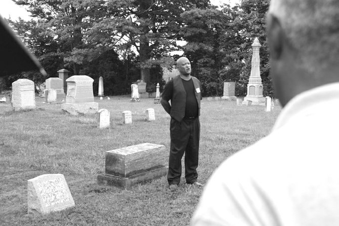 Max Smith offers a song during the 2011 commemorative ceremony where a newly purchased gravestone for his grandfather Willie Smith was installed for the first time. Each year wreaths are dedicated to the graves of Gerrit Smith and a freedom seeker who is buried the Peterboro Cemetery.