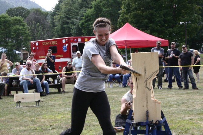 A competitor in the 2011 Stony Creek Mountain Days lumberjack contest whacks into a standing block of wood while the crowd observes. The five-hour competition, sanctioned by the NYS Lumberjacks Association, was scheduled to return to Stony Creek on Sunday Aug. 5, the third day of the 2012 Mountain Days festival.